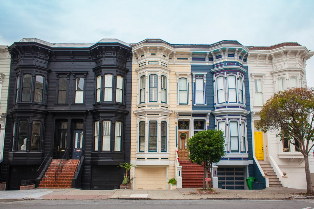 photo of a row of differently painted houses to illustrate a blog post about house style
