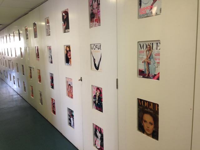 Magazine covers on the wall at Vogue