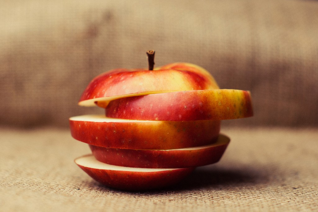 A photo of a sliced apple to illustrate a blog post called 7 ways to make your copy more succinct